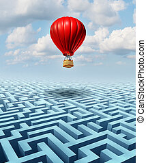 Rise above the challenges of business and life concept with a red hot air balloon with a businessman inside flying over a confusing maze or labyrinth puzzle as a metaphor for conquering adversity success with leadership.