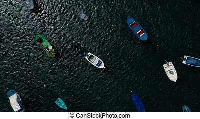 Rise above the many anchored boats off the coast. Las...