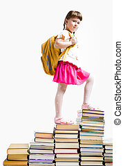 Rise - Image of serious schoolgirl standing on book stairs...