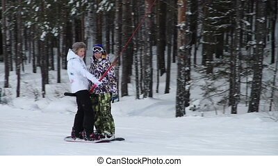 Rise on the lift. Snowboard