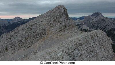 Rising above mountain ridge towards the top. Velika...