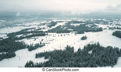 Rising aerial shot of mountain ski slopes in southern...