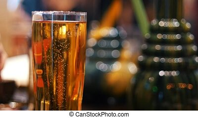 Rising bubbles in a glass of beer, close-up
