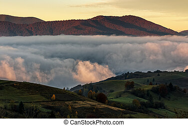 rising clouds in mountainous countryside before the dawn....