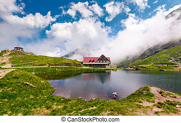 rising clouds on lake balea - Fagaras mountains, Romania -...