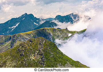 rising clouds over the Fagaras mountains of Romania....