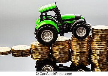 farmers in agriculture have to reckon with rising costs. higher prices for feed, fertilizer and plants. tractor with coins