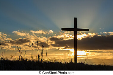 Sun behind a cross and a cloud too.