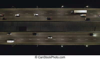 Rising drone shot reveals spectacular elevated highway, bridges, transportation and infrastructure development in urban area