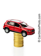 rising motoring costs. car on coins