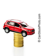 rising motoring costs. car on coins - rising cost of the car...
