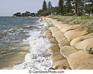 Rising sea levels - Erosion caused by rising sea levels due...