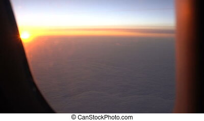rising sun above the clouds view from the window