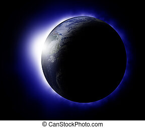 Rising sun behind planet earth