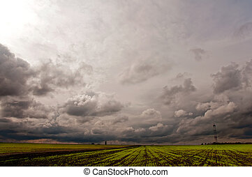 Rising Thunderstorm - A cloudy and rainy day in a field. ...
