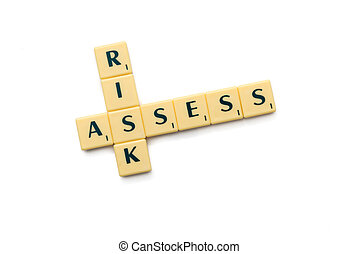 risk assess crossword letters on the white background