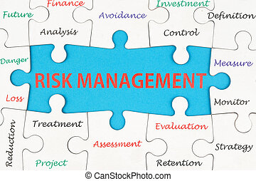 Risk management concept words on group of jigsaw puzzle ...