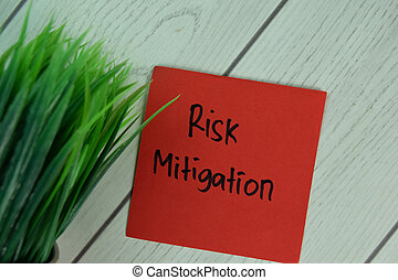 Risk Mitigation write on sticky notes isolated on Wooden Table.