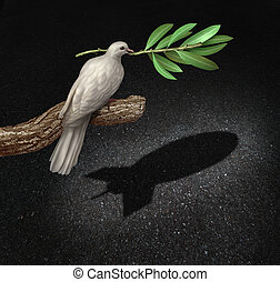 Risk of war concept as a freedom peace dove holding an olive branch casting a shadow that is shaped as a bomb as a symbol of the danger of warfare caused by hatred and political posturing.