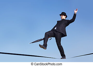 Risk - Photo of careful businessman with folded umbrella on...
