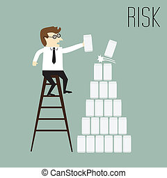 Risk, Businessman trying to put the cans on top