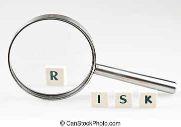 Risk word and magnifying glass