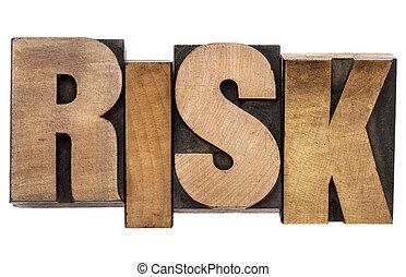 risk word in letterpress wood type