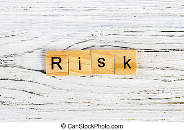 RISK Word Written In Wooden Cube concept