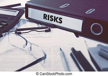 Risks on Ring Binder. Blured, Toned Image.