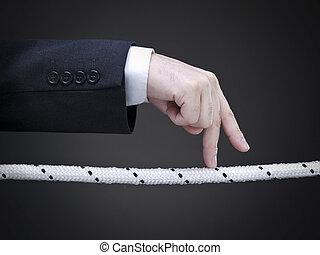 Risky business - Close up of a businessman\\\'s fingers...