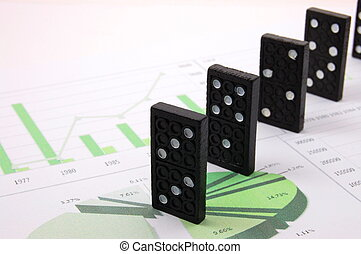 risky domino over a financial business chart - domino over ...