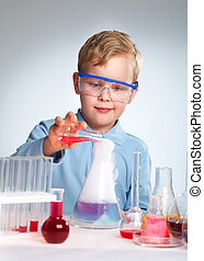 Schoolboy performing a risky experiment with boiling substances