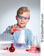 Risky experiment - Schoolboy performing a risky experiment ...