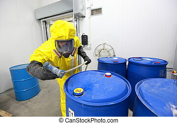 risky job - Professional in uniform dealing with barrels...