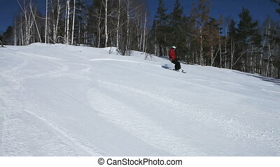 Risky snowboarders - Snowboarder outrunning his friends on a...