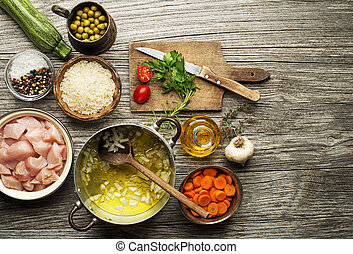 Ingredients with chicken and vegetables for cooking risotto