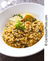 Salmon risotto with dill. Delicious seafood meal.