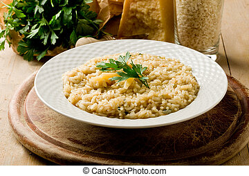 photo of delicious risotto dish with grana parmesan cheese