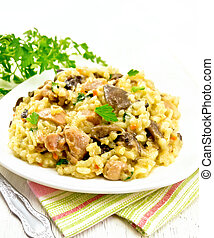 Risotto with mushrooms and chicken on towel