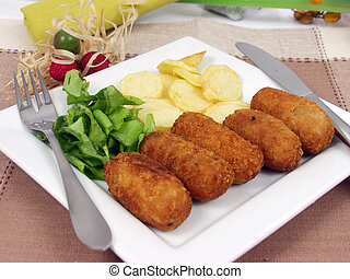 Rissole - chicken rissole with salad and potatoes on white ...