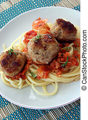 rissole with grilled organic tomato on a plate