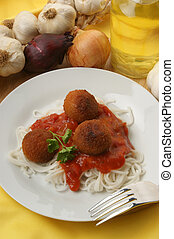 rissole with home made spaghetti on a plate