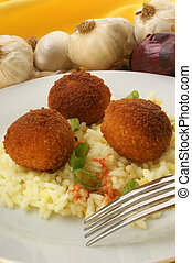 rissole with organic rice on a plate