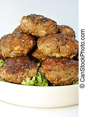 rissole with organic salad on a plate