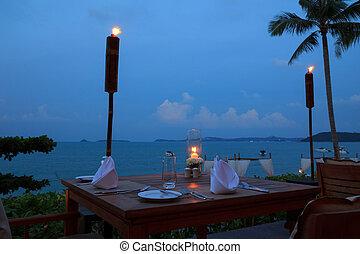 ristorante esterno, cena, sera, spiaggia, regolazione, tavoli
