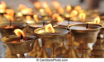 Ritual candles nearby Boudha stupa in the Nepal