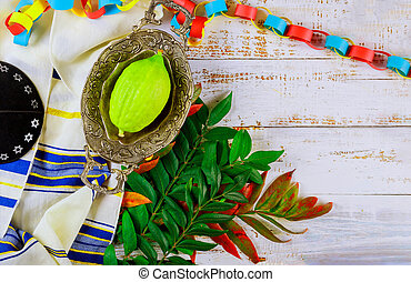 Ritual Jewish festival of Sukkot in the jewish religious symbol Etrog, lulav kippah and tallit