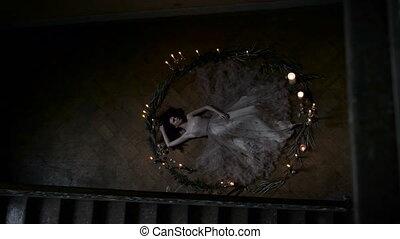 Ritual sacrifice or challenge spirits. Slim girl lying in a...