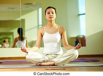 Ritual - Portrait of serene girl doing yoga exercise with...