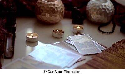 Ritual with tarot cards or fortune telling rite with occult and esoteric symbols.